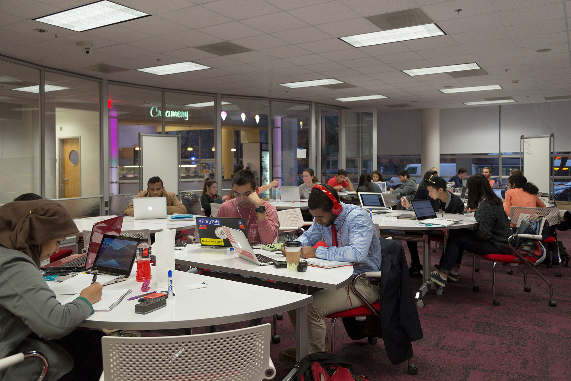 The Fishbowl Forum at DH Hill, a large glass walled room with desks, chairs, and whiteboards
