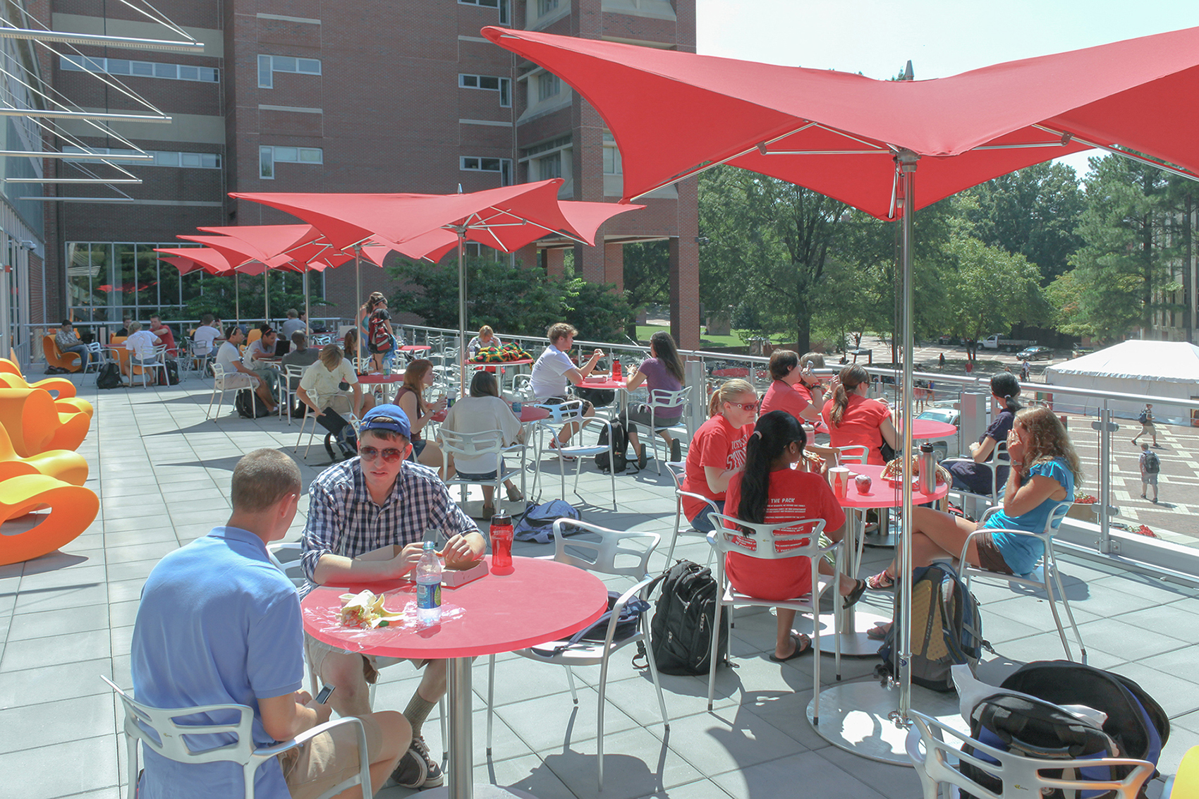 Students eat and work at tables on the terrace at DH Hill Library