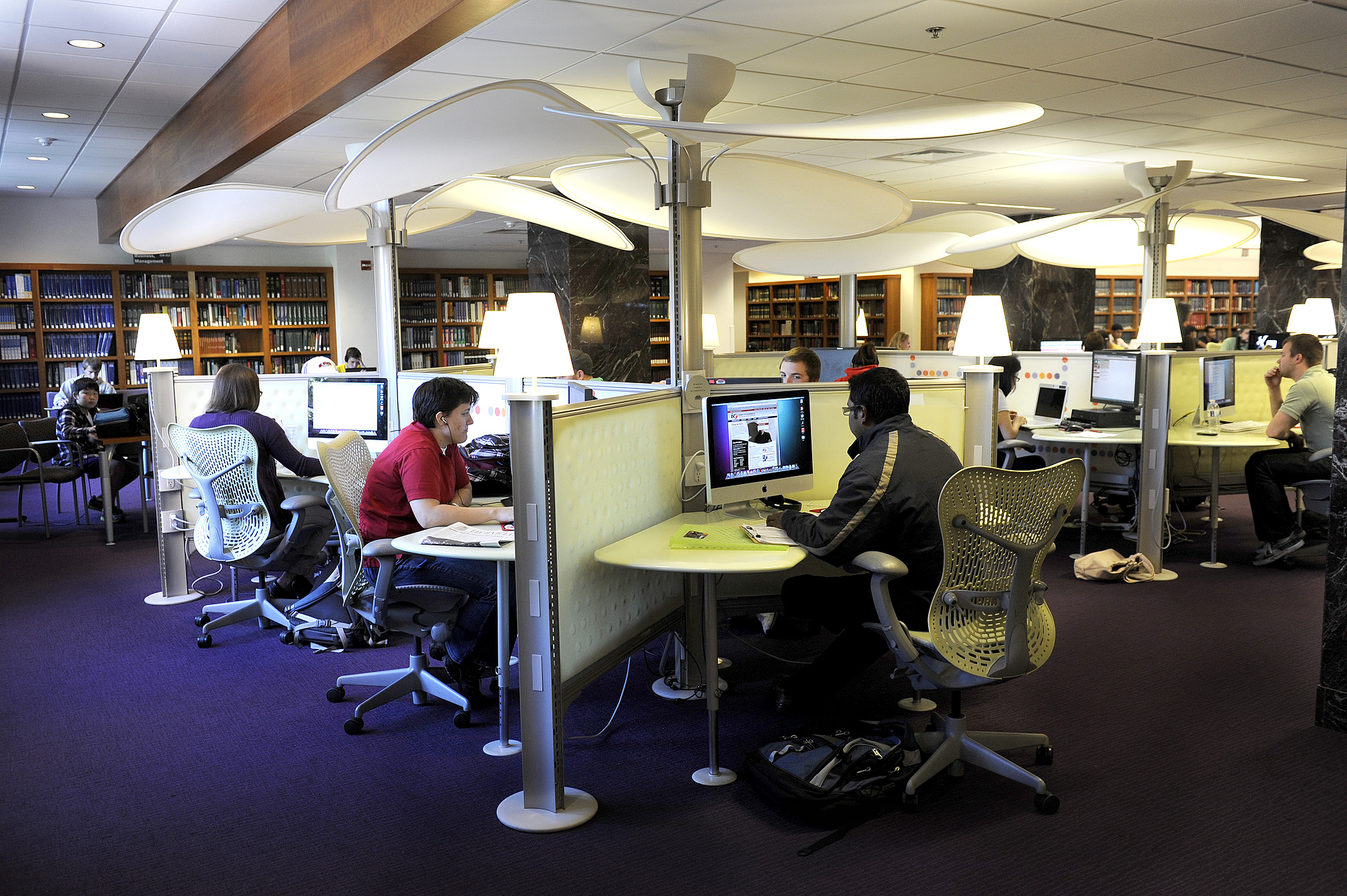 Students work at pods in the learning commons