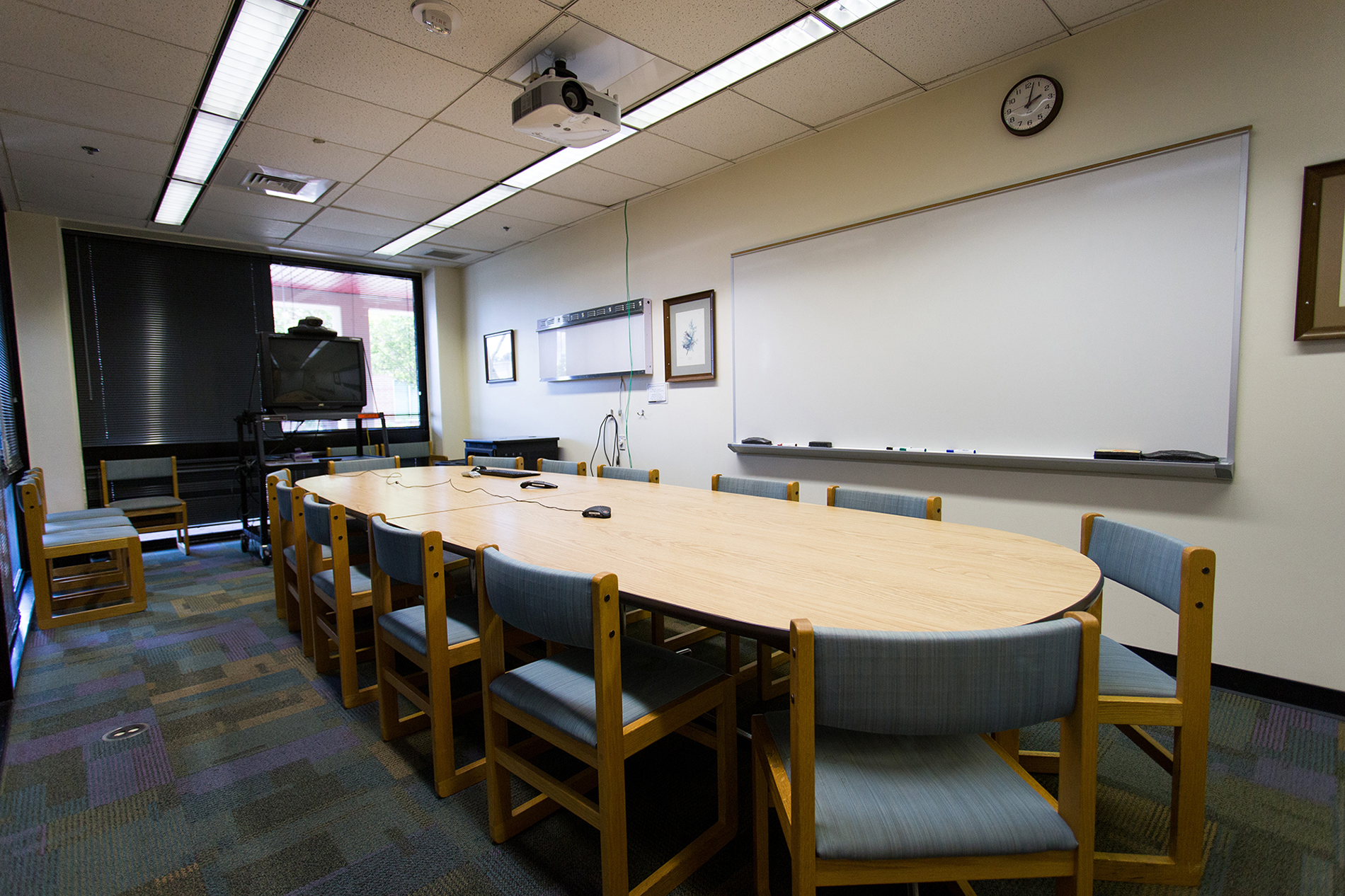 A large conference room with a whiteboard at the Veterinary Medicine Library