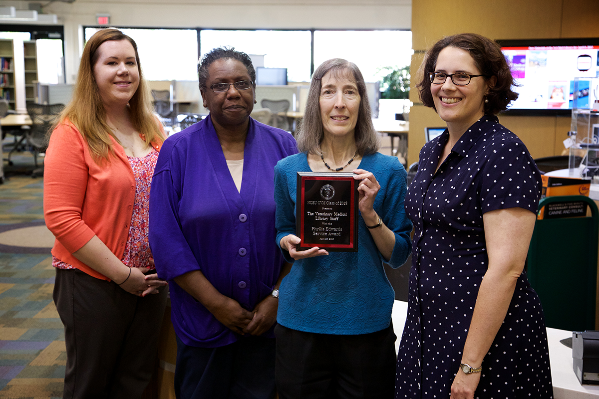 Kris Alpi and her team recognized with the Phyllis Edwards Service Award in 2013