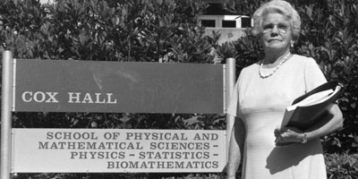 1960: Gertrude Cox standing in front of the building that bears her name. Cox Hall has been the primary home of PAMS since the college's founding.