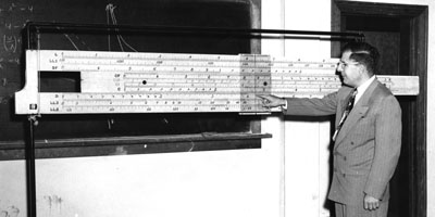 1950: Mathematics Professor John W. Cell and a giant slide rule.  Cell served on the NC State faculty for 32 years.  He served as department head from 1957 until his death in 1967.