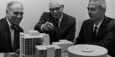 1961: Head of the Department of Chemistry, Ralph Clay Swann (center), and two others look at models of what are today Cox, Dabney and Harrelson Halls.