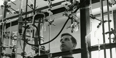 1970: Student working in a chemistry lab.